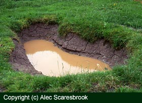 Copyright (c) Alec Scaresbrook. Cracked clay means a leaking pond